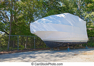 power boat wrapped in shrink wrap