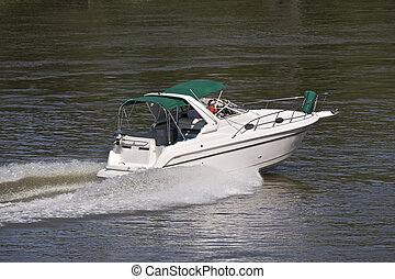 Power Boats speed up and down the river, especially on warm...