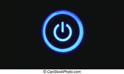Power button turning on and off on a dark background