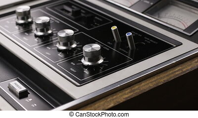 Power button with your finger. Close-up. Push the power button cassette player
