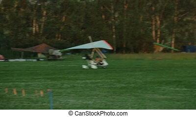 Power hang glider flies up in the sky