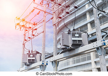 Power in urban: electrical post with power line cables transformers against office building