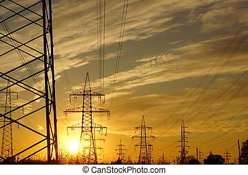 Power line against the backdrop of the setting sun