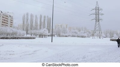 Power line masts in winter - Snow covered metal mast power...