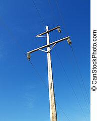 Power line. - Power line against blue sky.