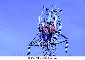 power line, pole with linemen - power line with two workers ...
