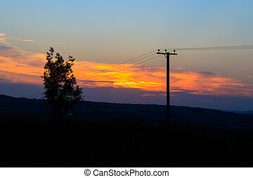 Power line silhouette at sunset in Yorkshire, UK.