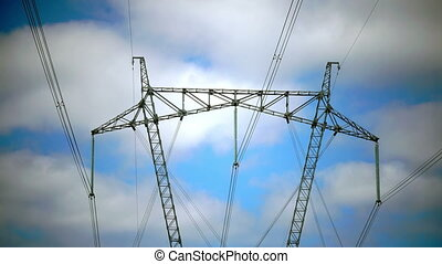 Power line support against the background of the blue sky...