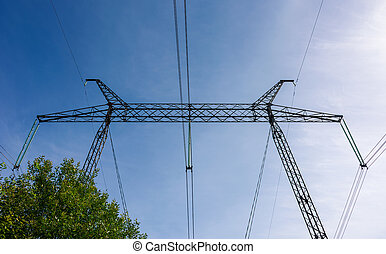 symbol of energy and power - power line tower on a blue sky...