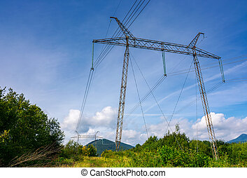 power line tower on a hillside. giant metal construction in...