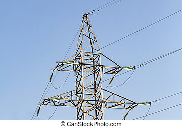 power line wires against blue sky part of metal tower