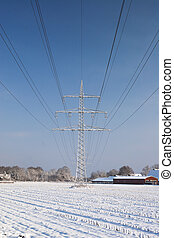 Power line with snow and blue sky