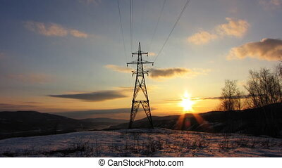 Power Lines 9 - Sunset with electricity pylon. Time lapse.