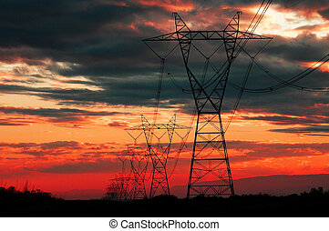 Power Lines at Sunset or Sunrise for Communication and Electricity