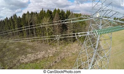power lines. Flight over high-voltage supports and wires -...