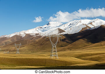 power lines in the mountains, kyrgyzstan,