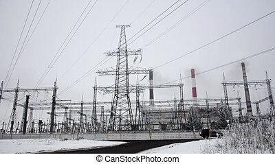 Power lines in the snow. Cogeneration plant in a strong blizzard