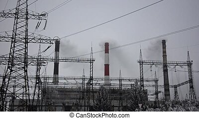 Power lines in the snow. Cogeneration plant in a strong...