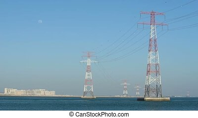 Power lines in water or river, long cables and wires in the...