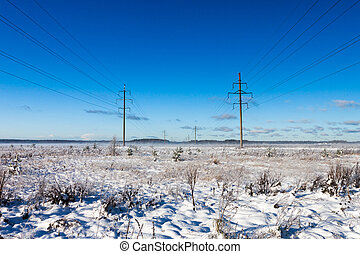 Power lines in winter snow field