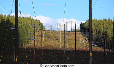 Power lines leading over Finnberget in Vasterbotten, Northern Sweden.