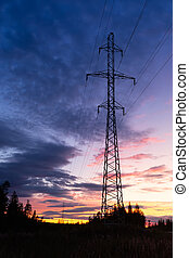 Power lines on sunset background