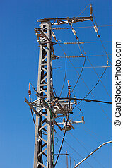 Power lines on a background of blue sky.