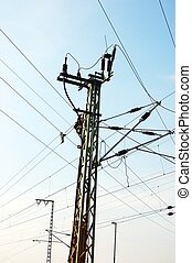 power lines and tower on background of blue sky...