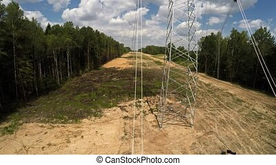 Power lines. Transmission of electricity. Installing pylons....