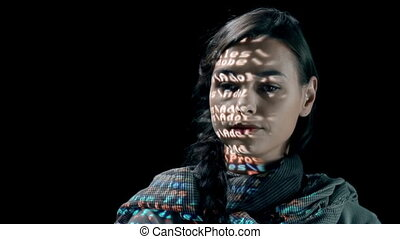 Power of Figures - Woman with binary code projected on her...