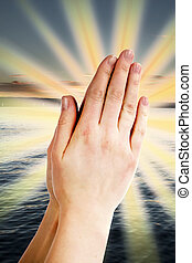 Power of Prayer - Praying hands with a landscape with the...