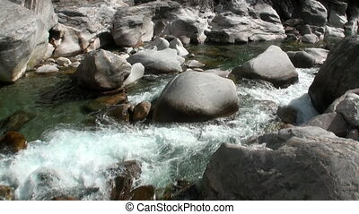 Power of water of mountain river Verzasca in valley of Swiss...