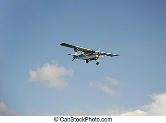 Power plane descending on the field