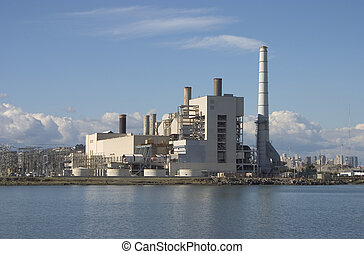 Power Plant - A large power plant churns out electricity to...