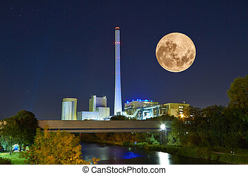 Power plant at night - A power plant is illuminated by ...