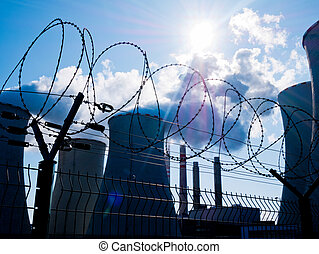 Power Plant bihand Fence with Barbed Wire.