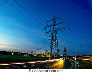 power plant by night - energy lines