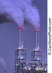 Power plant chimneys at night