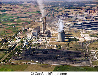 Power plant & coal piles, aerial - Fossil fuel power plant &...