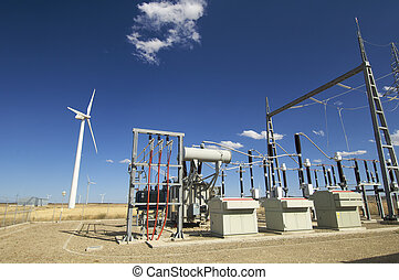 high-voltage substation and windmill with blue sky in Spain