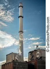 power plant smoke on dark sky