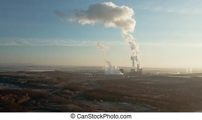 Power Plant Smoke - Power plant polluting the atmosphere in...