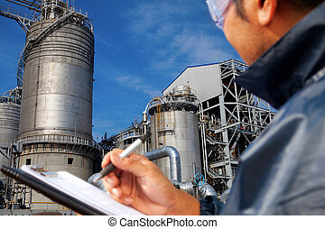 power plant - engineer oil refinery write on the notes book...