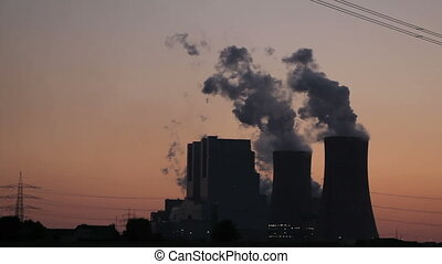 Power plant with power lines during sunset - brown coal...
