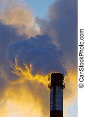 Power plant with smoke under sky