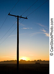Power pole at sunset.