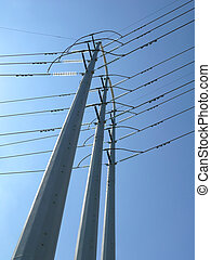power poles against blue sky