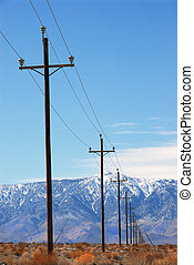 Power Poles Death Valley - Power poles lined up in the...