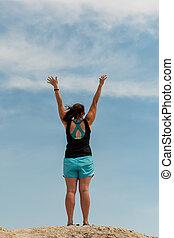 Power Posing Against Blue Sky