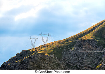 Power pylons in the mountains